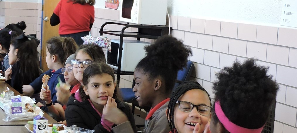 Elementary students eating in cafeteria