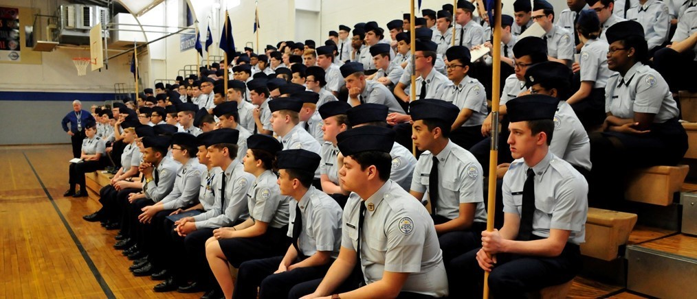 JROTC students sitting in gymnasium